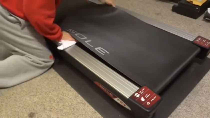 step 2, use a cloth to clean the treadmill deck